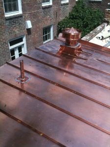 Standing seam copper roof and copper vent