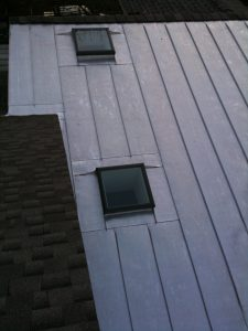 Standing seam metal roof with skylights