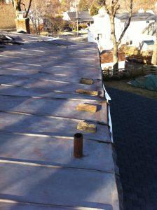 wind damaged metal roof
