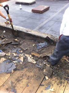 Built up tar and gravel roof being removed