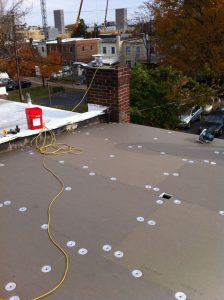 Iso board insulation being fastened to the roof deck