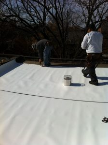 TPO roofing membrane being installed