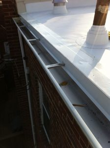 New gutter and drip edge on TPO roof
