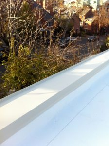 Flat roof with new wall coping