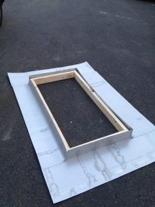 Skylight flashing kit for standing seam roof