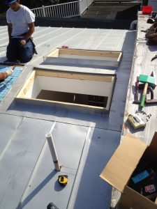 Skylight flashings for standing seam metal roof