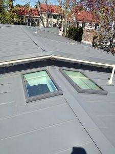 Nearly completed standing seam terne metal roof