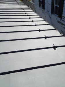 snow guards on standing seam metal roof