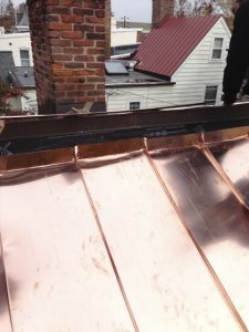standing seam copper roof wall detail