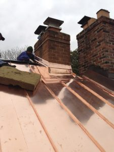 copper flashing for chimney on standing seam copper roof