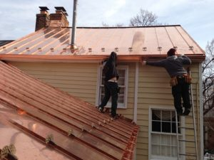 copper gutters on standing seam copper roof