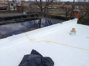 TPO flat roof with tapered insulation in Alexandria, VA; this roof will no longer have ponding water