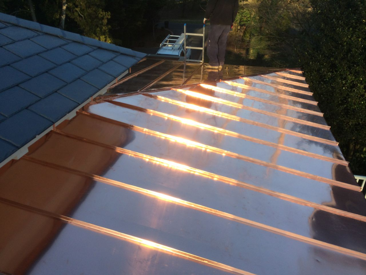 Hip And Ridge Detail On Standing Seam Copper Roof